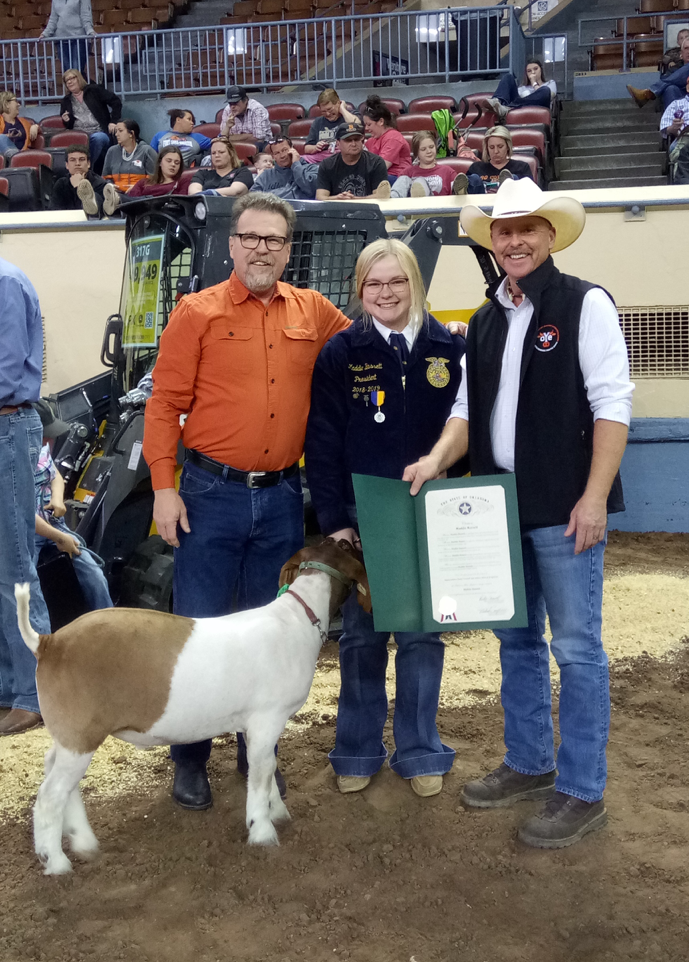 Senator Micheal Bergstrom, R-Adair (left) is joined by Rep. Rusty Cornwell and Bluejacket FFA president Maddie Bassett at the Oklahoma Youth Expo event at the State Fairgrounds this week.
