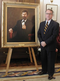 Former State Senator Gary Gardenhire with portrait of his great-great uncle, George W. Gardenhire, first President of the Territorial Council of Oklahoma.