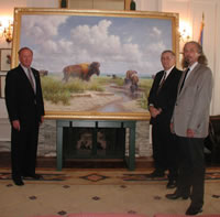 Senator Charles Ford, WILLIAMS Manager of Governmental Affairs Chuck DeHart, and artist Wayne Cooper with the painting of the Tallgrass Prairie Preserve.