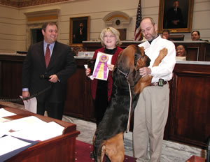 Sen. Coffee, Wendy and Chuck Musgrove and Westminster winner Barkley the Bloodhound.