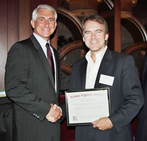 State Senator Jonathan Nichols (R-Norman) receiving a National Crime Fighter Award and being congratulated by the keynote speaker U.S. Congressman Dave Reichert (R-WA).