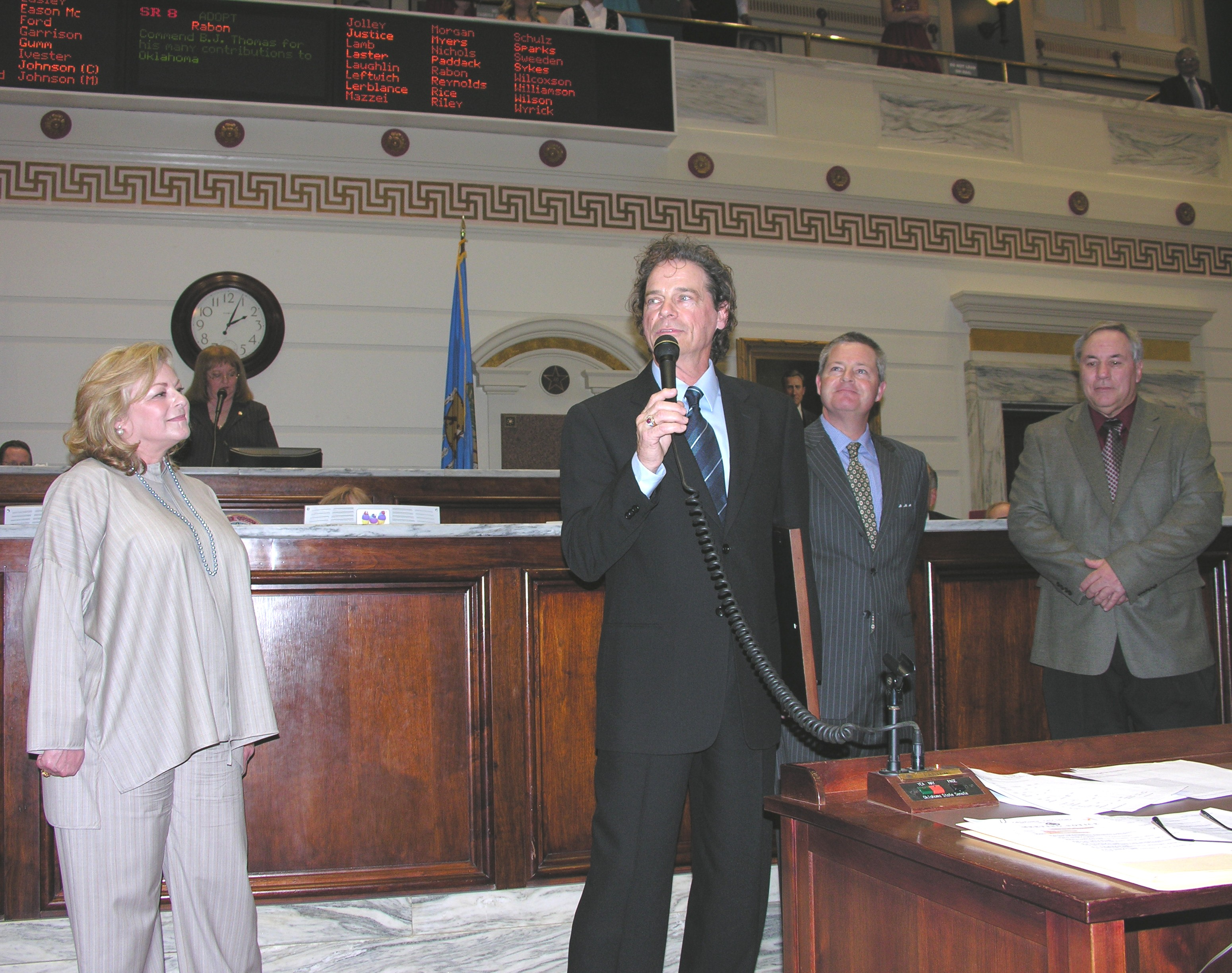 B.J. Thomas addresses Senate while his wife Gloria, Sen. Jeff Rabon and Huge Mayor Stan Payne look on