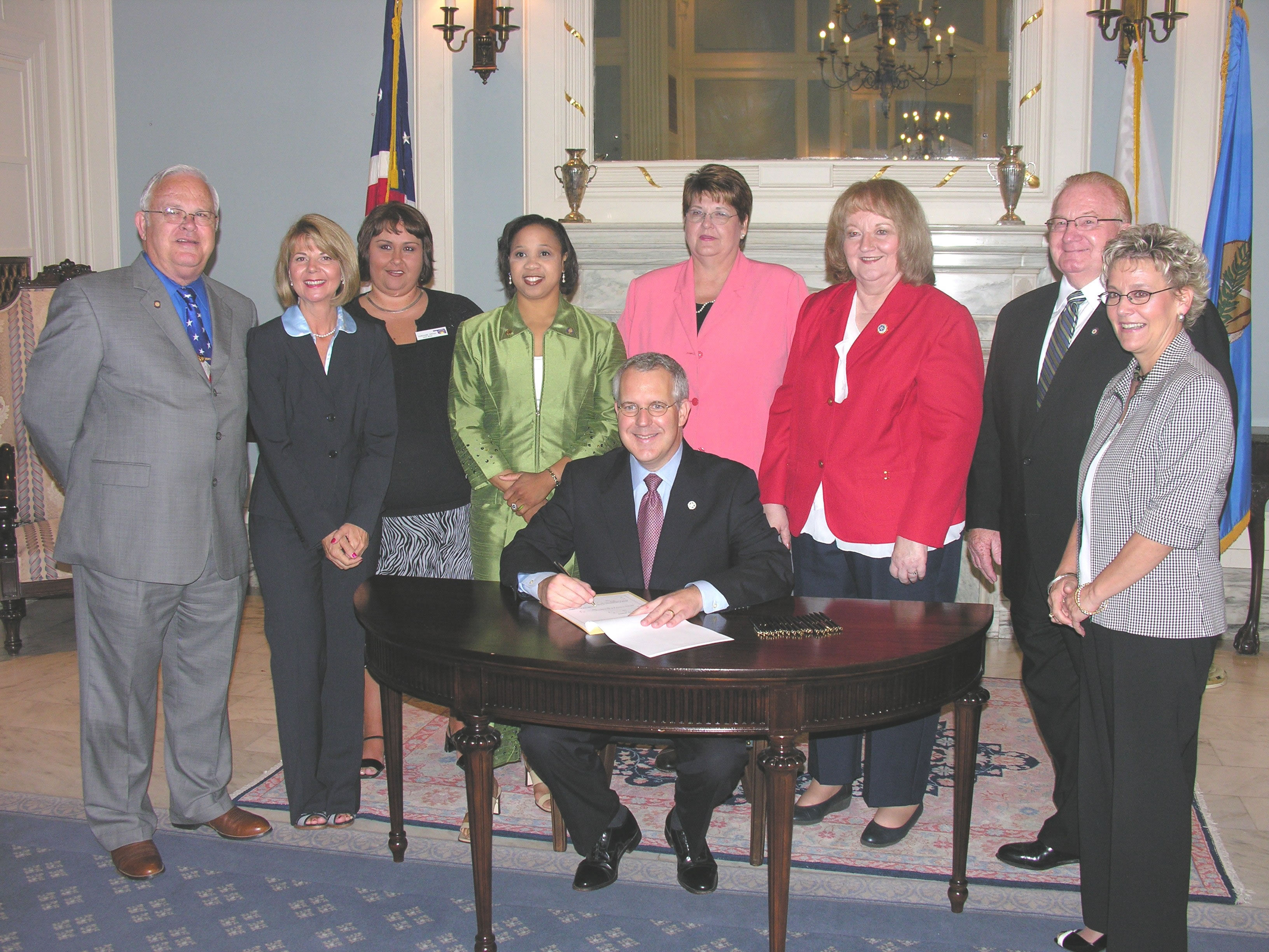 Ceremonial signing of Senate Bill 2163 in the Governor's Blue Room.