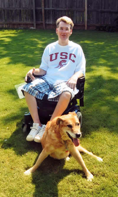 Charles and his beloved companion and service dog Hobbs at their home.