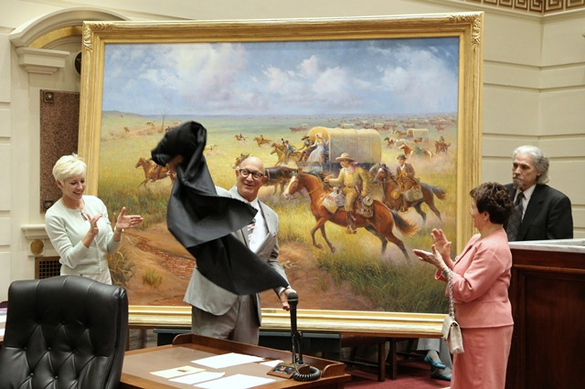 "Painting sponsor Brad Naifeh and artist Wayne Cooper unveil ""Land Run of 1889"" in Senate Chamber Monday alongside Brad's wife, Valerie, (on left) and his mother, Jeaneen (on right)."