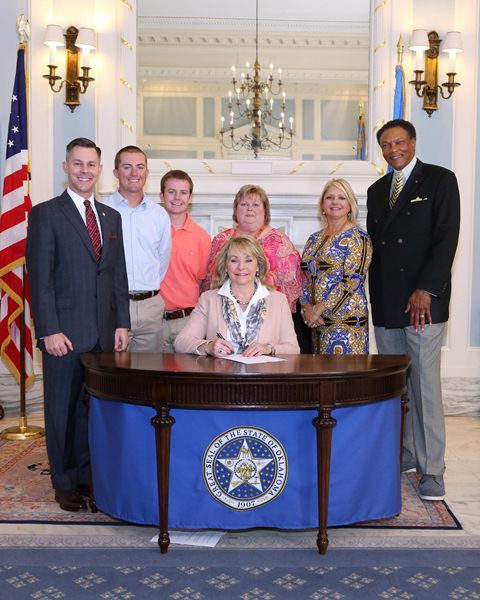 Gov. Mary Fallin held a ceremonial signing of SB 137 recently and was joined by the bill's author, Sen. Corey Brooks (R-Washington), as well as Dillon, Dustin and Dana Stanley, Melanie Wilkins and Kermit R. McMurry, Ph.D. Vice Chancellor- Student Servi