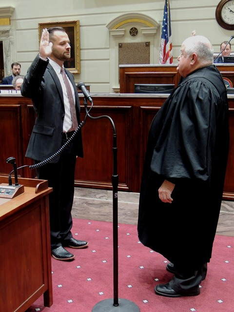Senator  J.J. Dossett was sworn in by Oklahoma Supreme Court Justice John Reif during a ceremony held Thursday at the state Capitol in the Senate Chamber.